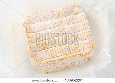 close up of unwrapped soft white rind cheese
