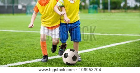 Kids kicking soccer. Children playing football soccer match