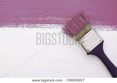 Stripe Of Plum Paint With A Paintbrush On White