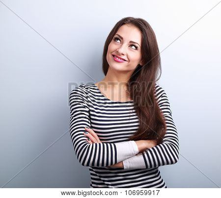 Happy Thinking Casual Girl With Folded Hands Looking Up
