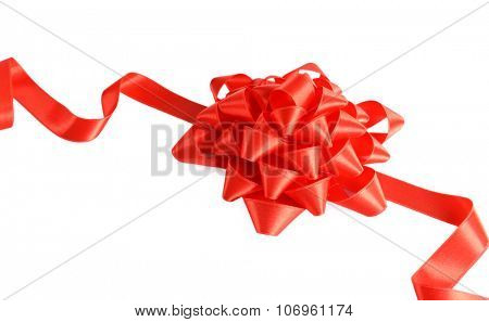 Red bow with curved ribbon isolated on white background