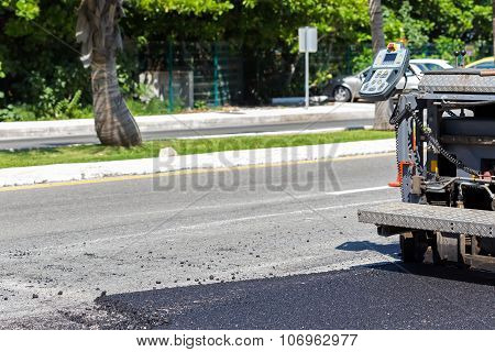 Pavement Truck Laying Fresh Asphalt