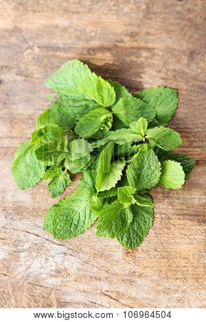 Bunch of mint on wooden background