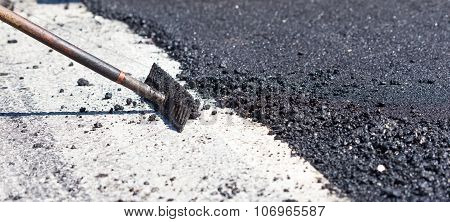 Workers Making Asphalt With Rakes