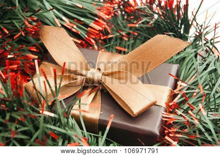 Brown Gift Box And Tinsel On White