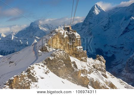 View to the Birg cable car station from the cable car gondola on the way to Schilthorn, Switzerland.