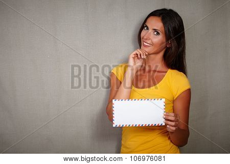 Charismatic Woman Holding Mail With Hand On Chin