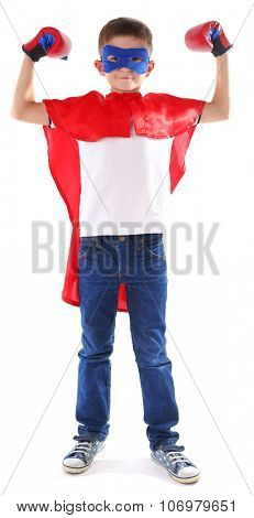 Boy dressed as superhero with boxing gloves poses in studio  isolated on white background