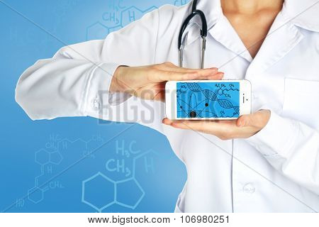 Young doctor holding smartphone with DNA molecule on screen