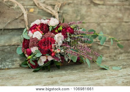bridal bouquet on wooden background