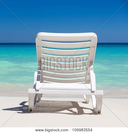 One Sunbed On Tropical Calm Beach With Turquoise Caribbean Sea Water