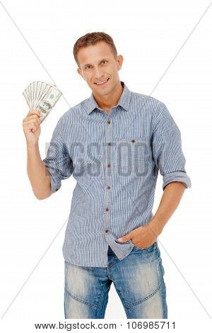 A Young Man Holding A Wad Of Cash Up In His Fist