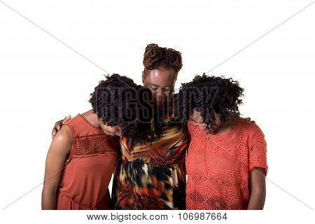 A mother and her daughters praying
