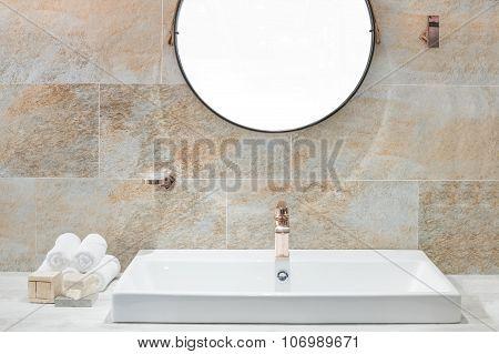 Washbasin And White Towel In Bathroom