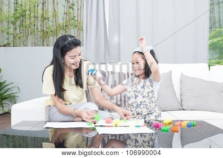 Family, Children And Happy People Concept - Asian Mother And Kid Daughter Playing
