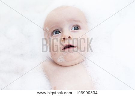 Toddler showing face just above water surface.