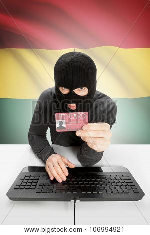 Hacker With Flag On Background Holding Id Card In Hand - Ghana
