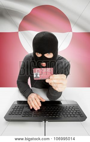 Hacker With Flag On Background Holding Id Card In Hand - Greenland