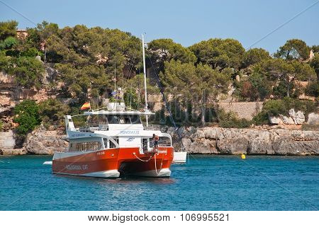 Red glass bottom catamaran