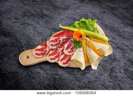 Prosciutto - Parma Smoked Ham With Vegetables On Wooden Board And Clipping Path
