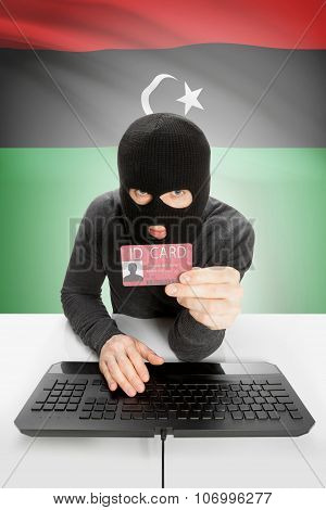 Hacker With Flag On Background Holding Id Card In Hand - Libya