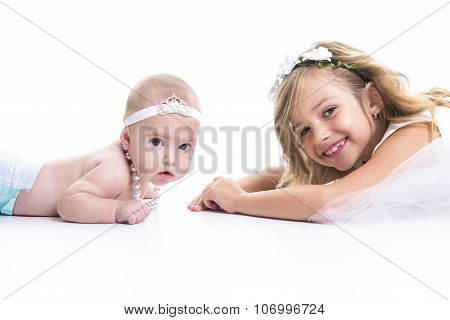 portrait of two sisters in white dresses