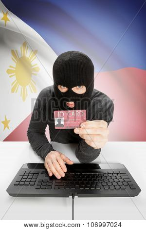 Hacker With Flag On Background Holding Id Card In Hand - Philippines