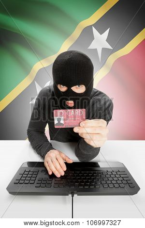 Hacker With Flag On Background Holding Id Card In Hand - Saint Kitts And Nevis