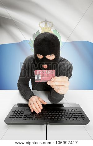 Hacker With Flag On Background Holding Id Card In Hand - San Marino