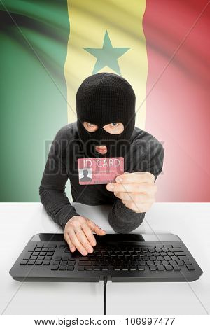 Hacker With Flag On Background Holding Id Card In Hand - Senegal