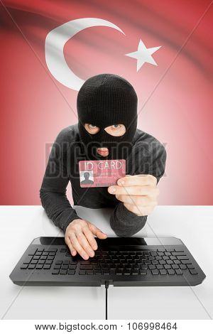 Hacker With Flag On Background Holding Id Card In Hand - Turkey