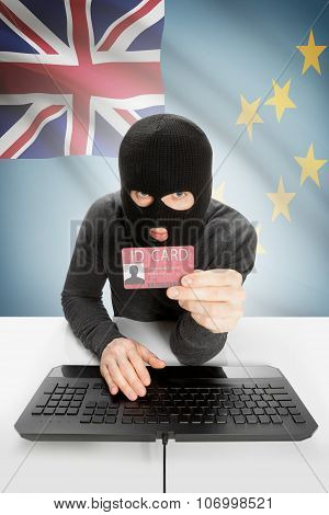 Hacker With Flag On Background Holding Id Card In Hand - Tuvalu