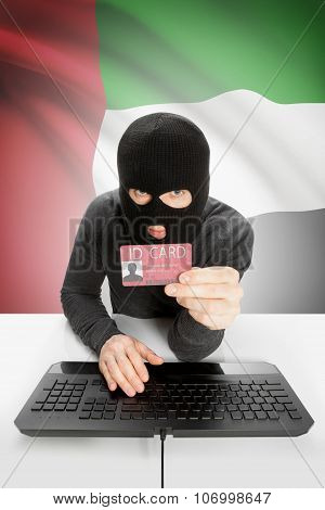 Hacker With Flag On Background Holding Id Card In Hand - United Arab Emirates
