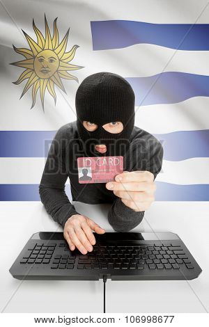 Hacker With Flag On Background Holding Id Card In Hand - Uruguay