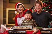 foto of nuclear family  - Christmas portrait of happy family of three looking at camera smiling - JPG