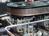 stock photo of carburetor  - A Weber carburetor with airfilter on a classic engine - JPG