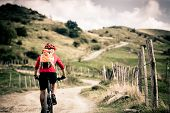 Mountain Bike Rider On Country Road, Track Trail In Inspirational Landscape poster