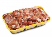 stock photo of giblets  - Raw frozen chicken gizzard in plastic plate - JPG