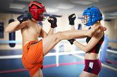 stock photo of muay thai  - Couple workout on ring - JPG