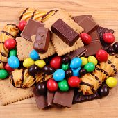 Постер, плакат: A Lot Of Sweets On Wooden Surface Unhealthy Food