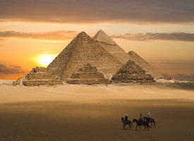 picture of pyramid shape  - the pyramids of gizeh near cairo in egypt during a golden sunset - JPG