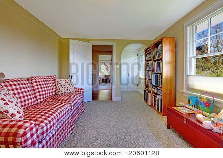 Small Green Room With Red Sofa And Book Shelve
