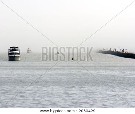 Boats And Fishermen In The Fog