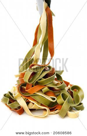 Serving fettucine, over white background.