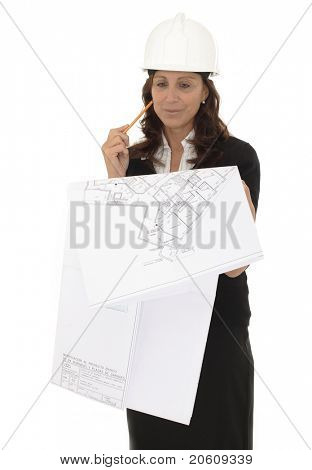 Closeup portrait of a mature female architect holding blueprints isolated on white background