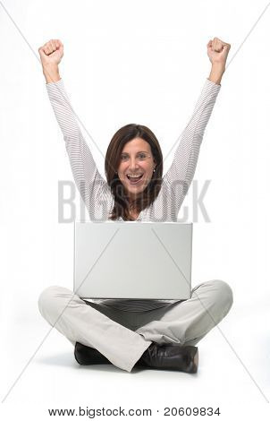 Isolated portrait of a beautiful business mature woman working on a laptop on the floor indicating success