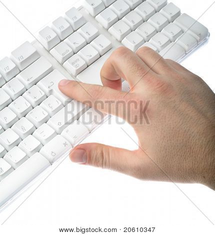 male hands typing on a white computer keyboard