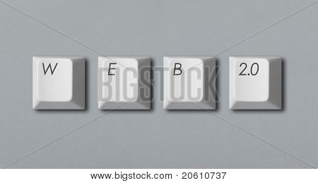 "Word ""web 2.0"" written with computer keys isolated on grey background"