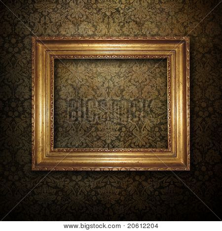 golden frame over grunge wallpaper