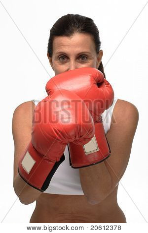 Mature woman wearing boxing gloves on guard